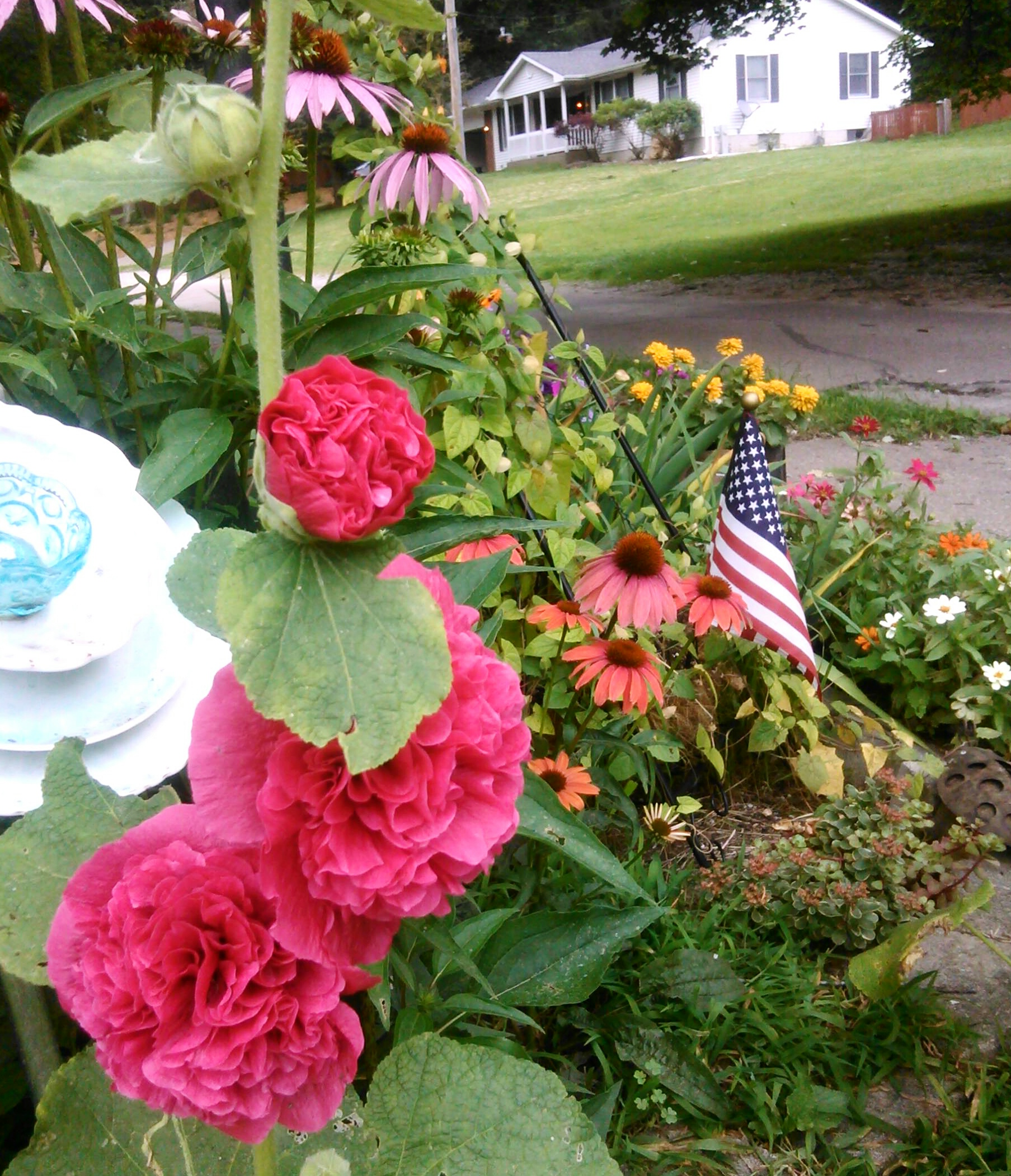 Patriotic flower garden with american flag for 4th of July by Shalom Schultz Designs. Independence Day. Freedom. Summer gardening decorations.