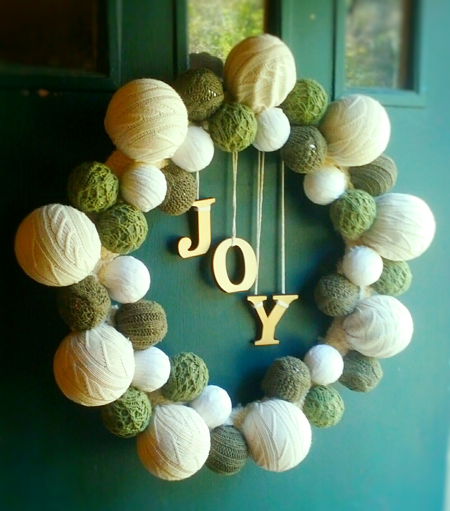 Handmade Sweater Ball Christmas Wreath by Shalom Schultz Designs. Recycled holiday decorating.