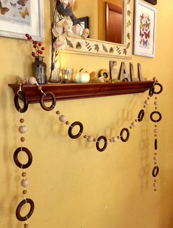 Handmade wood bead garland with vintage wooden curtain rings for fall or autumn decorating on mantel or shelf