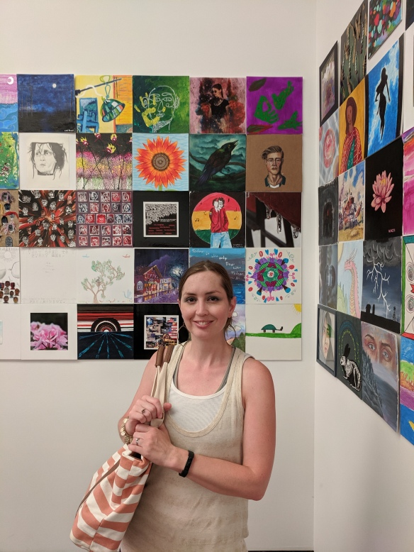 """Shalom Schultz in front of her work, """"Sunflower Study""""—part of a community art exhibit at Figge Art Museum in Davenport, IA."""